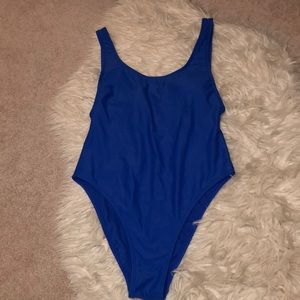 Sexy One piece, high cut on legs, scoop back